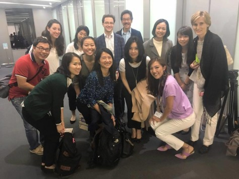 Hyeonseo Lee, in middle holding tan coat, with AAJA-Asia members after talking to them at a members-only event in Tokyo.